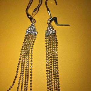 Bright gold tone and crystal dangle earrings